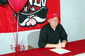 Dantley Walker, shown here after he signed his NCAA letter of commitment to UNLV in 2011, returns this month from his two-year LDS mission. The all-time Nevada high school scoring leader will join the UNLV mens basketball team this fall. (Courtesy photo)
