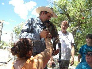 Susan Pulsipher, bottom, brought Dexter, her Capuchin monkey, to the movie shoot event, where he saw his long-time friend, Dakota Whidden (Rachel Williford photo)