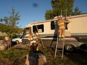 Pioche Volunteer firefighters work on an RV at the Pioche Free RV park that suffered extensive interior damage from an early morning explosion and fire believed to have originated in the propane powered refrigerator. There were no injuries. (Courtesy photo)