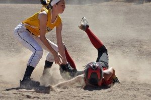 Lincoln County's Alisha Rowe dives back to 3rd base under the tag and is safe during the championship game with Enterprise. (Courtey photo)