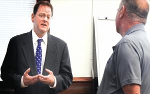 Attorney Simeon Herskovits speaks with White Pine County Commissioner Richard Howe. (Lukas Eggen photo)