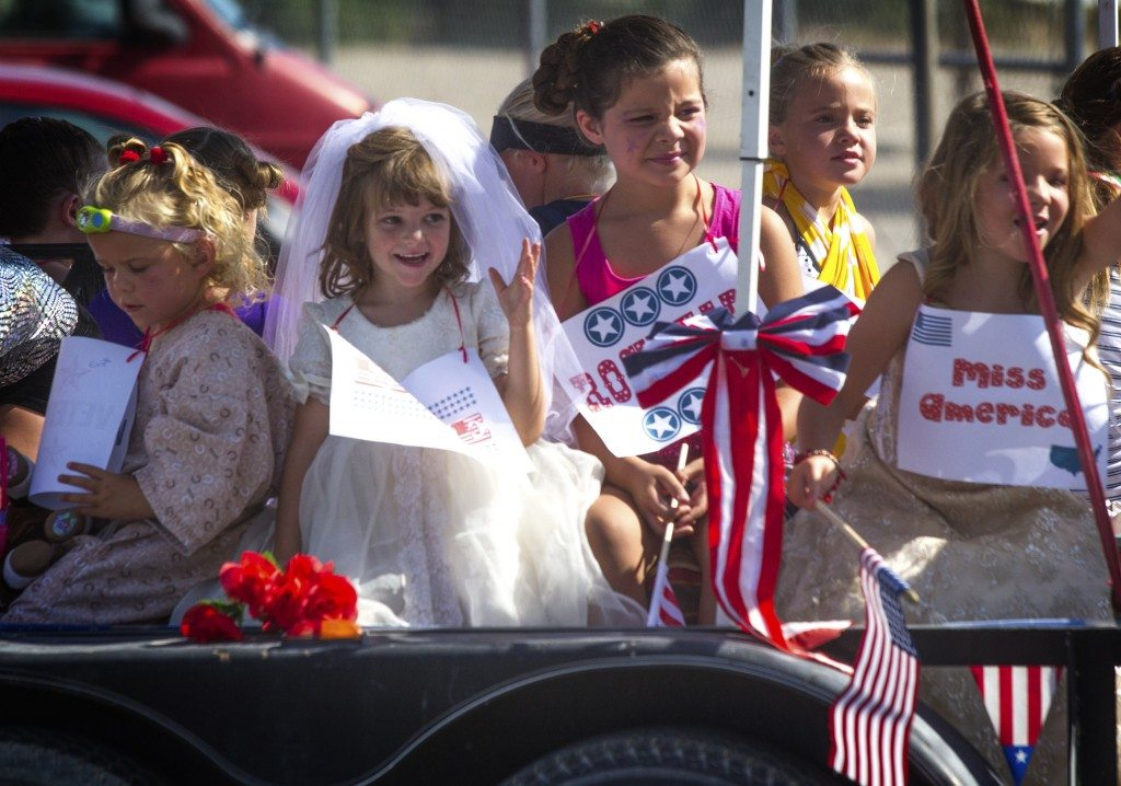 Children ride a float in the  Independence Day Parade in Alamo on July 4. (Battle Born Media photo)