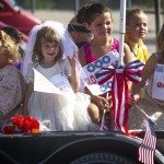 Children ride a float in the Independence Day Parade in Alamo on July 4.