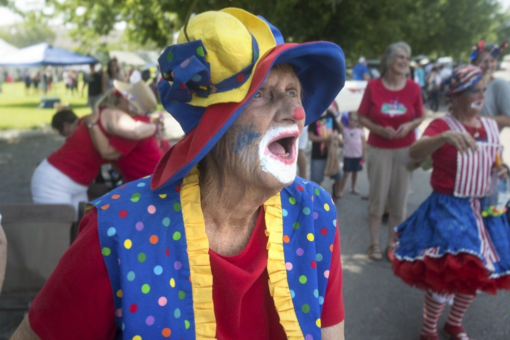 """Susan Evans, 84, dressed as """"Smiley"""" the clown at the Alamo parade."""