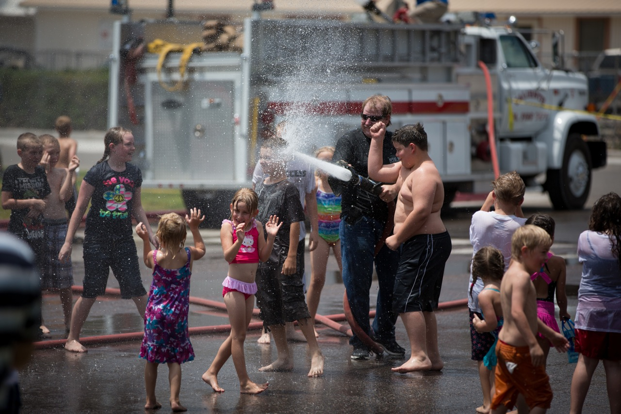 The Caliente Volunteer Fire Department holds an annual water spray for the children that let them run in the street in front of the Caliente Elementary school while they get soaked by the fire truck hoses.