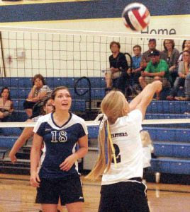 Alamo seniors Jamie Hansen and Jade Jewitt keep the ball in play in a recent match. PVHS opened league play this week facing Tonopah on Friday.