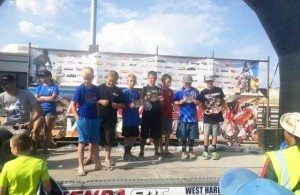 Local participants Kobe Kelley and Hagen Boyce (third and fourth from right) take the stand after racing in the Jr. Mini division at the National Hare and Hound race in Panaca. Boyce took first, while Kelley finished fourth.