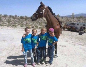"Four youngsters show off their ""Tuff Like Tyce"" shirts. A Gymkhana benefit, Riding for Tyce, for 2-year-old Tyce Campbell was held on Saturday at the Alamo Rodeo Grounds."