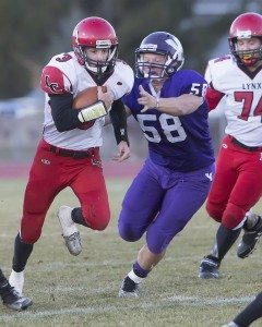 Lincoln senior quarterback McClain O'Connor fights for yards during the Lynx battle with Yerington for the state title on Saturday. The Lynx fell to the Lions 21-8.