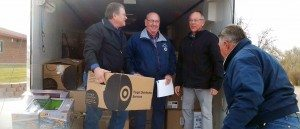 Marie Mason Bob Ellis of Henderson and friends spent the day of Dec. 3 delivering shoes, socks and toys to county elementary students. From left: Jim Roberson, Bob Ellis, former Henderson mayor Jim Gibson and Jerry Carnahan.