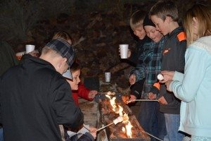 Sarah Somers Kids roast marshmallows during the annual Christmas Tree Lighting Monday evening in Pioche.