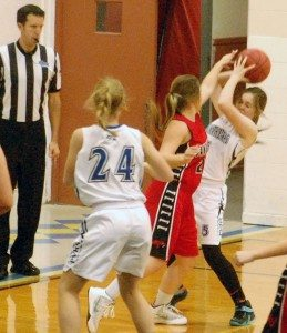 Dave Maxwell Allyse Frehner of PVHS is defended by a Sandy Valley player as Madi Taylor looks to get a pass. Tonight, the Lady Panthers play at Round Mountain in an important league matchup.