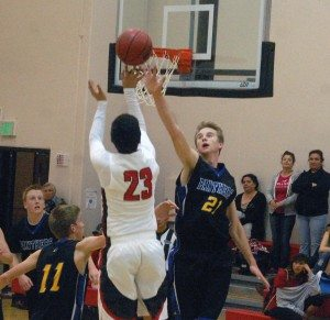 Dave Maxwell Culen Highbe contests the shot of a Beaver Dam player. Pahranagat won the game with a strong second half showing. The Panthers finish the regular season tonight hosting Indian Springs.