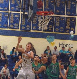 Dave Maxwell Jacob Roemer under the basket for the PVHS boys in their game with Virgin Valley. The Panthers play at Word of Life this Saturday.