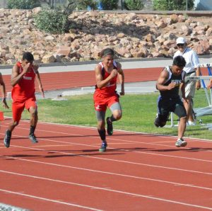 Noah Smith, freshman, running the 100 meter dash on Friday, April 22 at the Boulder City Invitational at Boulder City High School. Courtesy photo.