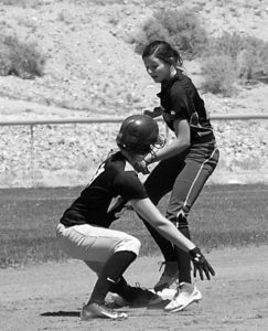 Morgan Harris tags out Round Mountain's Alyssa Hanks at second base after Hanks had overrun the bag. Pahranagat won both league games 17-1, 15-5. Today, PVHS plays Beaver Dam. Photo by Dave Maxwell