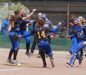 Pahranagat girls celebrate winning the deciding game 3-2 over Wells for the state championship in Sparks. It was their fourth straight, and ties them with four other schools for the most consecutive state titles.