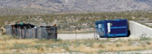 Dave Maxwell - A new Western-Elite dumpster sits at a transfer station near the burned out recology dumpsters