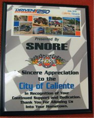 Rose Lanigan -  The Southern Nevada Off Road Enthusiasts presented a plaque to the City of Caliente in appreciation of hosting the group's recent race.