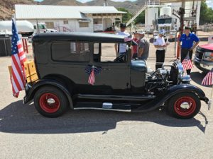 Rose Lanigan - A patriotic 1929 Ford Model A was entered by Bill Williams of Pioche into the Caliente parade