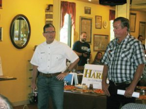 Rose Lanigan U.S. Senate candidate Joe Heck (left), with Rep. Cresent Hardy, speaking to a gathering at Pioneer Pizza in Caliente.
