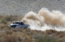 One of the Best in the Desert trucks kicks up dust and dirt on the course.