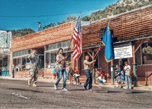 Kristal Romans -  Scouts present the U.S. and Nevada flags to begin the parade.