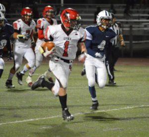 Kristina Lloyd - Senior Zach Rowe runs in a touchdown during Lincoln County High School's 36-0 shutout of Agassi Prep last Friday in Las Vegas.