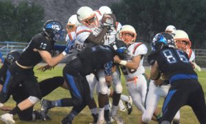 Dave Maxwell photos Pahranagat players stack up Thacher's Lawrence Jackson in their game last Saturday. The Panthers won 22-8 for their 95th consecutive victory.