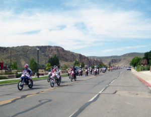 Rose Lanigan -  A long line of racers ride through Caliente during the parade prior to Silver State Trailblazers Muley Run last weekend.