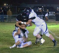 Dave Maxwell - Garrett Higbee sacks Round Mountain quarterback Corbin Jensen in the Panthers 54-0 win last Friday.