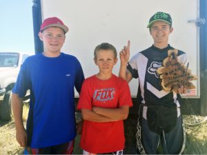 Sarah Somers - From left, Wyatt Woodworth (2nd), Tegan Somers (3rd) and Troy Young (1st) all placed in the 85cc novice class at the MRAN race in Pioche.