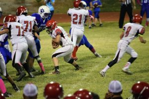 Courtesy Photo - Lincoln's Matt Harr looking for running room during the Lynx shutout win at Laughlin last Friday.