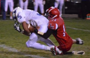Kristina Lloyd - Lincoln junior Elijah Harr gets the tackle during the Lynx big win over Needles last Friday.