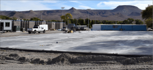 Dave Maxwell - The concrete slab is in place for the new auto and industrial arts shop at Pahranagat Valley High School. The 100 by 200 steel frame building will be able to service school buses under cover, and is expected to open in January or February.
