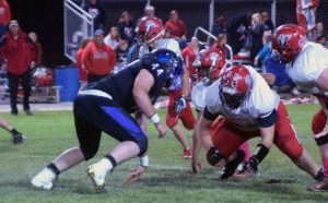 Dave Maxwell: Pahranagat's Garrett Higbee lines up on the defensive line in a recent game.  Pahranagat Valley plays host to Sandy Valley tonight.  Next week's game with Beatty is on Thursday, Oct. 27.