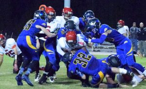Christian Higbee and Pahranagat Valley teammates tackle Sandy Valley running back Cole Payne. The Panthers won 55-6. They played Beatty last night to finish the regular season. The playoffs begin next Friday night in Alamo.