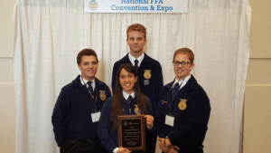 Dave Maxwell - Members of the Pahranagat Valley High FFA chapter attended the FFA National Convention in Indianapolis. Team members are Leatitia Ray, front, Haigen Huntsman, left, Culen Highbe, back, and Chris Thornton, right.