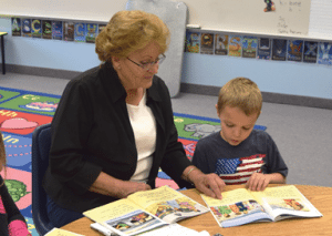 Dave Maxwell - Mrs. Arda Higbee, volunteer reader, helps the second grade kids at Pahranagat Elementary school. Principals say such a volunteer program is very helpful to students.