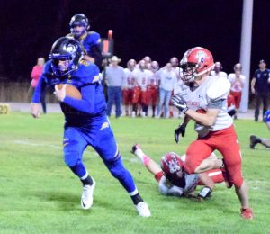 Tabor Maxwell breaks away from Tonopah defenders in the Panthers playoff game last week. The senior quarterback will lead Pahranagat Valley into the state semifinal game against Whittell tonight at 6 p.m. in Alamo.