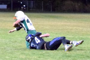 Ike Taylor brings down Micheal Olson of Beatty with a touchdown saving tackle in Pahranagat Valley's 50-14 win. The Panthers begin the state playoffs tonight hosting Tonopah.