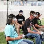 Thi Van, left, and three other drone racers competing in the Alamo Shootout Races.