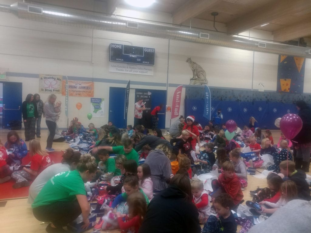 After a countdown of three, two, one, the students at Caliente Elementary tore the wrapping paper from the boxes set before them. They wore big smiles on their faces as they displayed their presents to one another, the shoes within each box seeming to match the personalities of individual children.