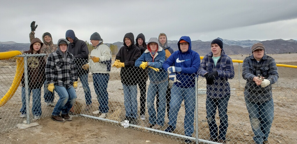 Eagle project puts up fencing at Alamo softball field