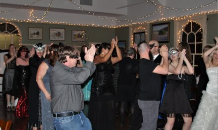 Local group puts on masquerade ball