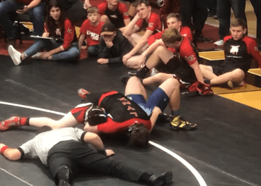 Wrestlers hit the mat at Milford tourney